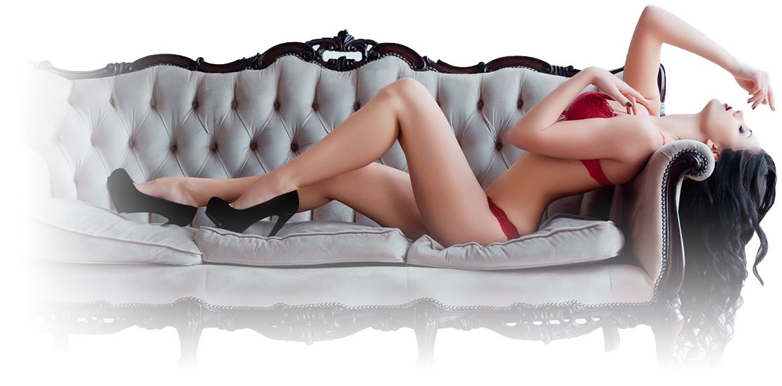 Long Island Escorts posing in red lingerie on sofa